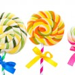 Colorful lollipops with ribbons isolated on white — Stock Photo #10811891