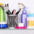 Shelf with cosmetics and toiletries in bathroom — Foto Stock