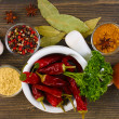 Stock Photo: Composition of mortar with peppers and vegetables and spice on wooden background