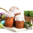 Beautiful Easter cakes, colorful eggs in basket and pussy-willow twigs isolated on white - Stock Photo