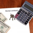 Stock Photo: Rental contract with dollars on wooden background close-up