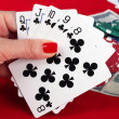 Stock Photo: Woman's hand holding playing cards straight flush