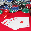 Stock Photo: Royal flush on a red poker table close-up