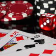 Stock Photo: Full house of poker chips and dice on black background close-up