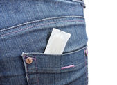 Condom in the pocket of blue jeans on white — Stock Photo