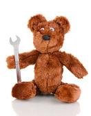 Sentado urso de brinquedo com chave isolado no branco — Fotografia Stock