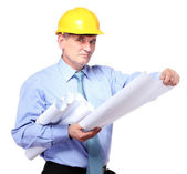 Man architect with helmet and drafts isolated on white — Stock Photo
