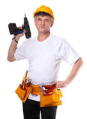 Builder with belt construction and holding drill isolated on white — Stock Photo