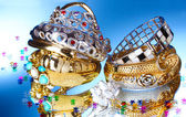 Beautiful silver and gold bracelets and ring on blue background — Стоковое фото