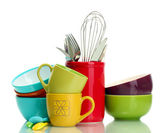 Bright empty bowls, cups and kitchen utensils isolated on white — Stock Photo