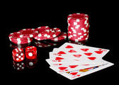 Flush with poker chips and dice on black background — Stock Photo