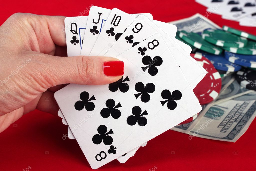 Woman's hand holding playing cards straight flush — Stock Photo #10814526
