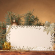 Blank postcard, Christmas balls and fir-tree on wooden table on brown background - Foto Stock