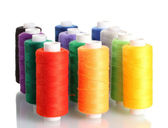 Many-coloured bobbins of thread isolated on white — Stock Photo