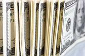 A lot of one hundred dollar bills closeup — Stock Photo