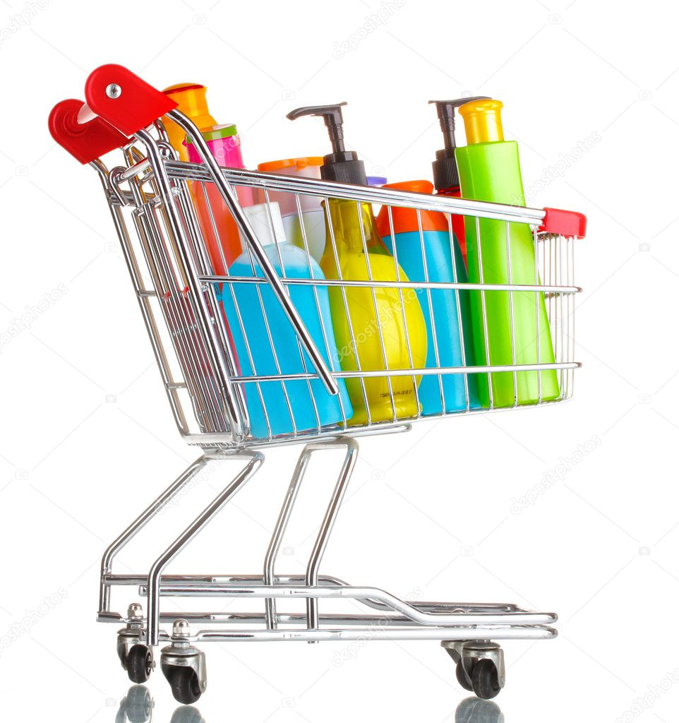 Shopping cart with detergent bottles isolated on white — Stock Photo #10821189