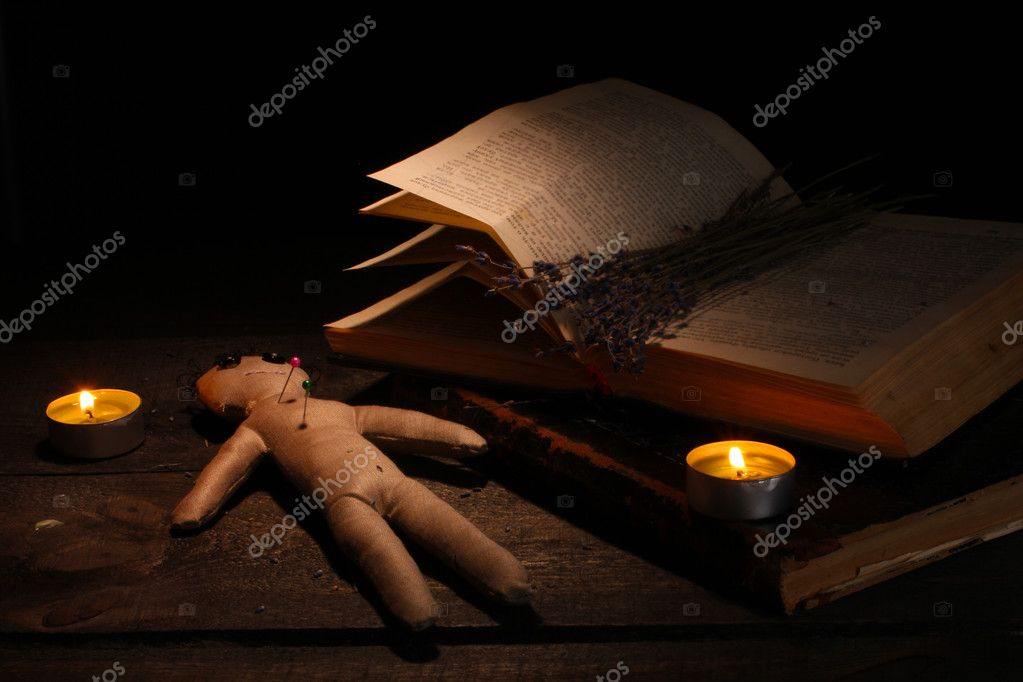Voodoo doll boy on a wooden table in the candlelight  Stock Photo #10828488
