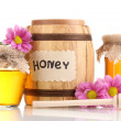 Sweet honey in barrel and jars with drizzler isolated on white — Stock Photo #10891882