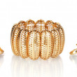 Beautiful golden bracelet and rings isolated on white — Stock Photo #10892521