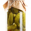 Marinated cucumbers in a glass jar isolated on white — Stock Photo #10893908