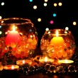 图库照片: Wonderful composition of candles on wooden table on bright background