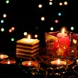 Foto Stock: Wonderful composition of candles on wooden table on bright background