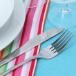 Table setting with fork, knife, plates, and napkin — Stock Photo #10898609