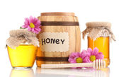 Sweet honey in barrel and jars with drizzler isolated on white — 图库照片