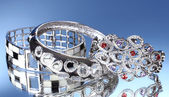 Mooie zilveren armbanden op blauwe achtergrond — Stockfoto