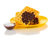 Tasty waffles with chocolate on plate isolated on white — Fotografia Stock