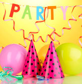 Party items on orange background — 图库照片