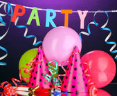 Party items on purple background — 图库照片