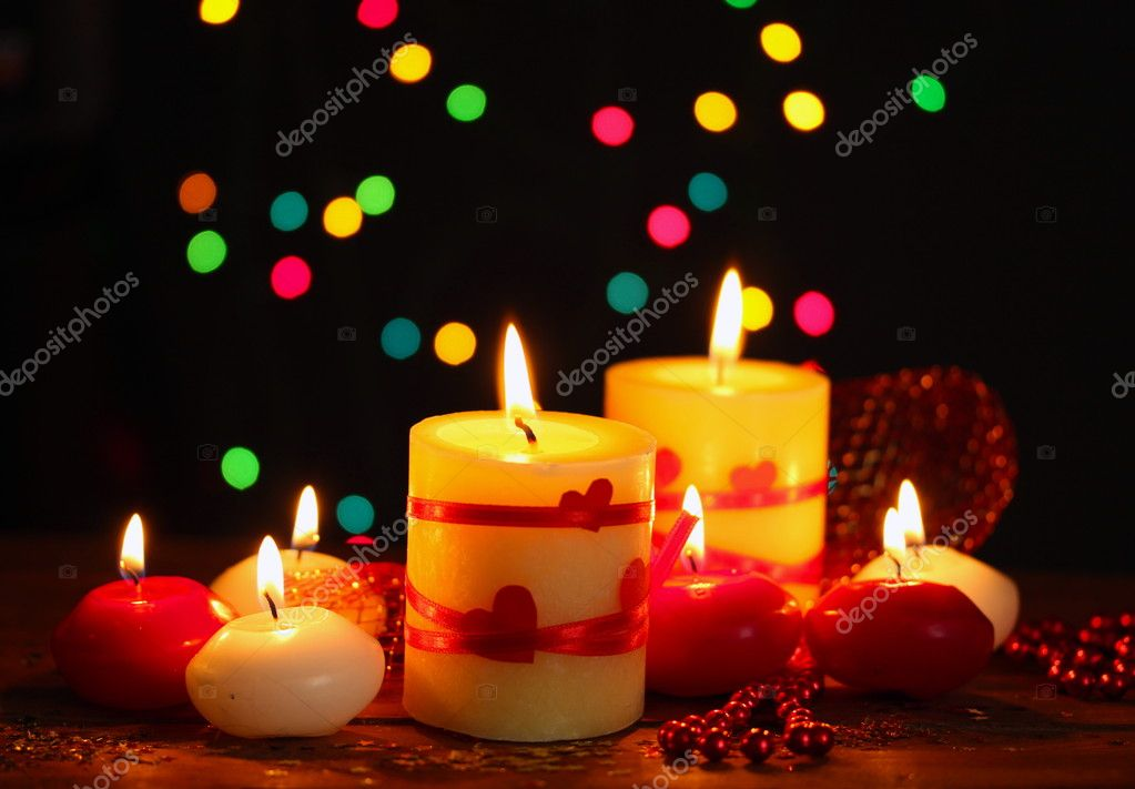 Beautiful candles on wooden table on bright background — Stock Photo #10891373