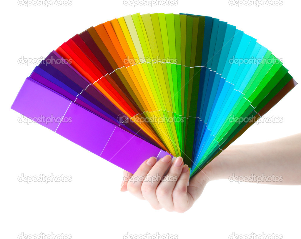 Hand holding bright palette of colors isolated on white — Stock Photo #10892115