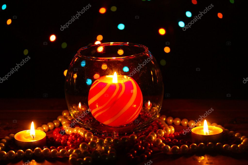 Wonderful composition with candle in glass on wooden table on bright background — Stock Photo #10896002