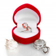 Silver ring with red, pink and clear crystals in red velvet box and some silver rings isolated on white — Stock Photo #10922309