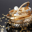Beautiful golden bracelets on grey background - Lizenzfreies Foto
