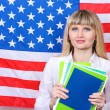 Young woman on the background of the flag of America — Stock Photo #10922396