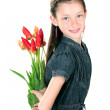 Portrait of beautiful little girl with tulips isolated on white — Stock Photo