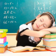 Little schoolgirl sleep in classroom near blackboard — Stock Photo #10922535