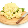 Fresh cauliflower and knife on cutting board isolated on white — Stock Photo