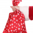 Santa Claus hand holding bag of gifts isolated on white — Stock Photo #10923323