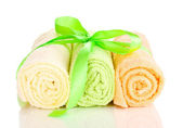 Colorful towels with ribbon isolated on white — Stock Photo