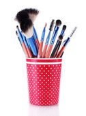 Make-up brushes in red cup isolated on white — Stock Photo