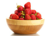 Sweet ripe strawberries in wooden bowl isolated on white — Stock Photo