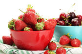 Ripe strawberries and cherry berries in bowls isolated on white — Stock Photo