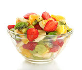 Glass bowl with fresh fruits salad isolated on white — Stock Photo