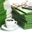 Stock Photo: Many green folder with cup of coffee closeup
