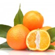 Ripe tasty tangerines with leaves and segments isolated on white — Stock Photo #10940810