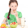 Little beautiful girl have a breakfast on white background — Stock Photo #10941265